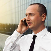 Portrait of young man talking phone — Stock Photo
