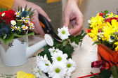 Florist making composition of different cut flowers — Stock Photo