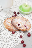 Cookies in powdered sugar with cranberries and milk — Stock Photo