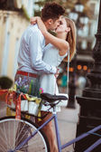 Wedding- couple with bicycles in the city — Stock Photo
