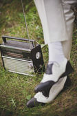 Man in urban shoes and retro radio — Stock Photo