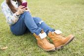 Beautiful girl in the park, close-up shoes — Stock Photo
