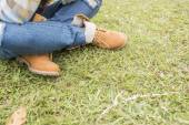 Beautiful girl in the park, close-up shoes — Stok fotoğraf