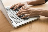 Closeup of business woman hand typing on laptop keyboard — Stock Photo