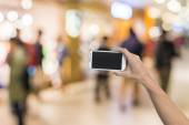 Using smartphone in a subway, closeup image. — Photo