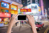 Using smartphone in a market or department store, closeup image. — Stock Photo