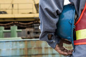 Man holding blue helmet close up — Stock Photo