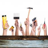 Hands with construction tools. House renovation background. — Stock Photo