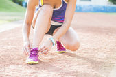 Woman wearing running shoes on the park — ストック写真