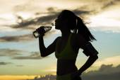Runner drinks water after training — Stock Photo