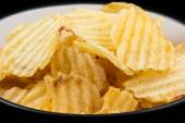 Ribbed potato chips in a bowl — Stock Photo
