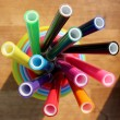 Multicolored felt pens in plastic cups — Stock Photo #77588418