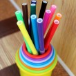 Multicolored felt pens in plastic cups — Stock Photo #77588436