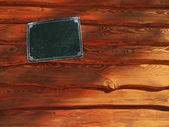 Wooden planks with nameplate — Stock Photo