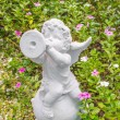 Fairy Statue in the garden with flower — Stock Photo #52272003