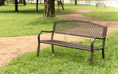 Wooden park bench at the public park image — Stockfoto