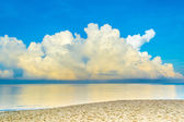 Blue sea and cloudy blue sky over it. — Stock Photo