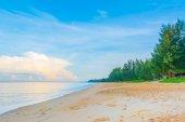 Blue sea and cloudy blue sky over it. — Foto de Stock