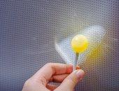 Lollipop in hand — Stock Photo