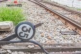 Vecchio palo lampada sulla ferrovia — Foto Stock