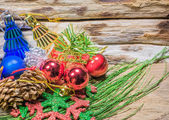 Chrismas baubles and vary of decoration on wood background — Stock Photo