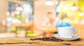 Coffee shop blur background with bokeh image. — Stock Photo