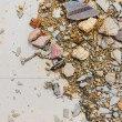 Image of small pebble rock on cracked cement ground  texture. — Stock Photo #68898129