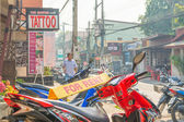Image of Unidentified motorcycle for rent and tourists in Chian — Stock Photo