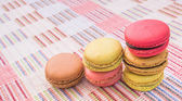 Sweet and colourful french macaroons on cotton cloth background. — Stock Photo