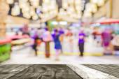 Blurred image of people walking at shopping mall — Stock Photo
