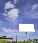 Advertisement bill board with blue sky in background. — Stock Photo