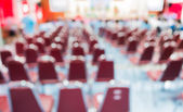 Blurred image of people in auditorium — Stock Photo