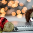 Christmas bauble ornaments, decoration with silver Christmas present and ribbon on blurred, bokeh background — Stock Photo #60371331