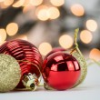 Gold and red Christmas ornaments with ribbon on blurred, bokeh background — Stock Photo #60371365