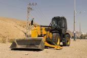 Yellow tractor - dozer - pitchfork — Stock Photo