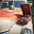 Moscow, Russia - June 29, 2014: Car cowl GAZ-M-20 Pobeda with an old record player and a lying flag on show of collection Retrofest — Stock Photo #52692717