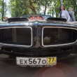 Постер, плакат: Moscow Russia June 29 2014: The black sports car with the air inlet taken out outside on show of collection Retrofest cars