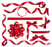 Various red bows, knots and ribbons isolated on white — Stock Photo