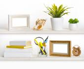 Wooden shelves with different office related objects — Stockfoto