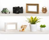 Wooden shelves with travel memory related objects — Stock Photo
