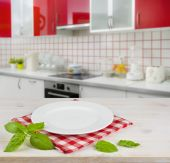 White plate on table placemat over modern kitchen interior background — Stock Photo