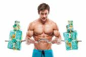 Muscular bodybuilder guy with gifts — Foto de Stock