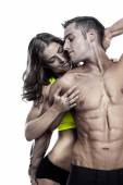 Sexy couple, muscular man holding a beautiful woman isolated on — Stock Photo