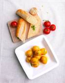 Boiled potatoes with baguette and vegetables — Stok fotoğraf
