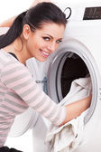 Woman launderers clothes — Stock Photo