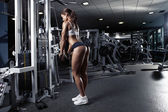 Nice sexy woman doing triceps workout — Foto de Stock