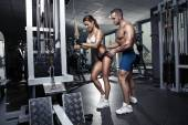 Beautiful young sporty sexy couple in gym — Foto de Stock