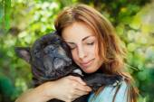 Happy woman with french bulldog — Stock Photo