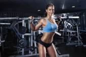 Beautiful sexy young woman in gym — Stock Photo