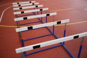 Row of cross-country barriers in the athletics hall — Stock Photo